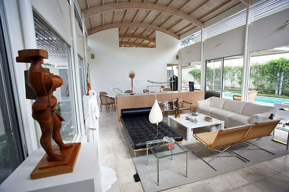 The wooden barrel-vault ceiling in the Terrell Hills home of Ken and Carol Bentley was influenced by the Alamo. A sculpture by Phil Evett looks over the living/dining room; other pieces of contemporary art are placed throughout the room, which is bathed in natural light. Photo: Photos By Danny Warner / For The Express-News