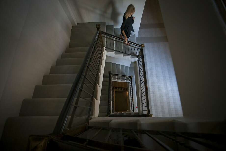 Residents of the Park Lane, a luxury building on Nob Hill in San Francisco, have been taking the stairs, above, during renovations that have cut power to elevators. One of the units, below, is prepared for the conversion. Photo: Sam Wolson, Special To The Chronicle