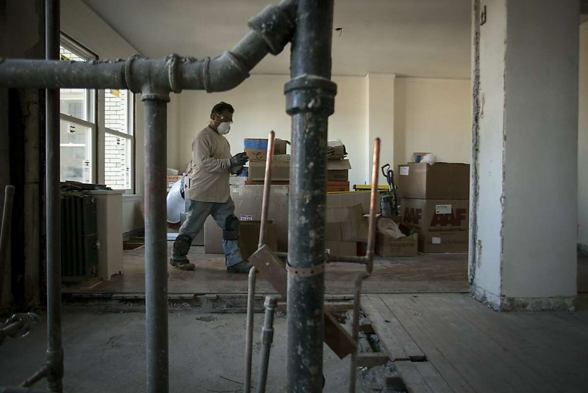 A worker renovates an apartment in the Park Lane, a Nob Hill apartment building on September 19th 2013. Apartments in the building will soon go on sale making the building one of the most expensive TICs in the city.