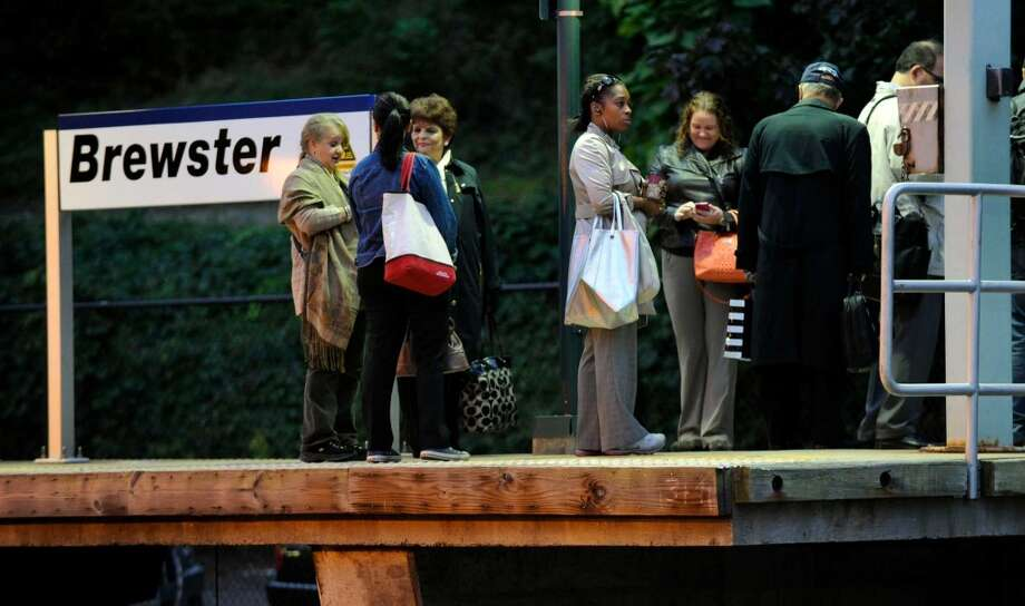 Commuters wait at the Brewster, N.Y. Train Station for the 6:44 a.m. train to Grand Central Stationin New York, Thursday morning, Sept. 26, 2013. A damaged high-voltage feeder cable affected Metro-North rail service on the New Haven Line for days last fall. Photo: Carol Kaliff