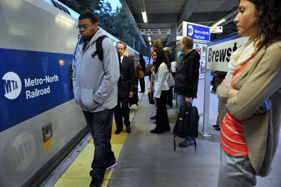 Commuters wait at the Brewster, N.Y. Train Station for the 6:44 a.m. train to Grand Central Station in New York City, Thursday morning, Sept. 26, 2013.  A damaged high-voltage feeder cable affected Metro-North rail service on the New Haven Line for days last fall. Photo: Carol Kaliff