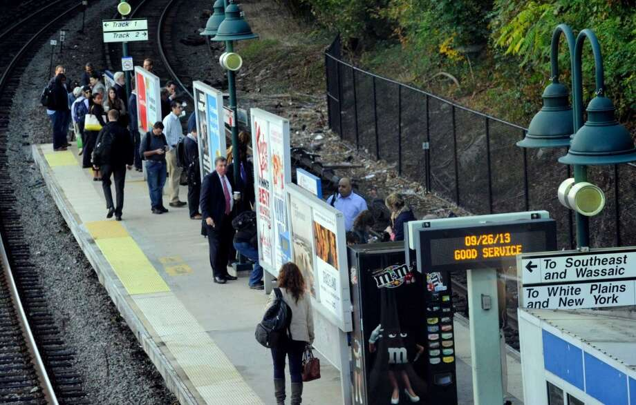 Early morning commuters wait for a train from Brewster, N.Y. into Grand Central Station Thursday morning, Sept. 26, 2013.  A damaged high-voltage feeder cable affected Metro-North rail service on the New Haven Line for days last fall. Photo: Carol Kaliff