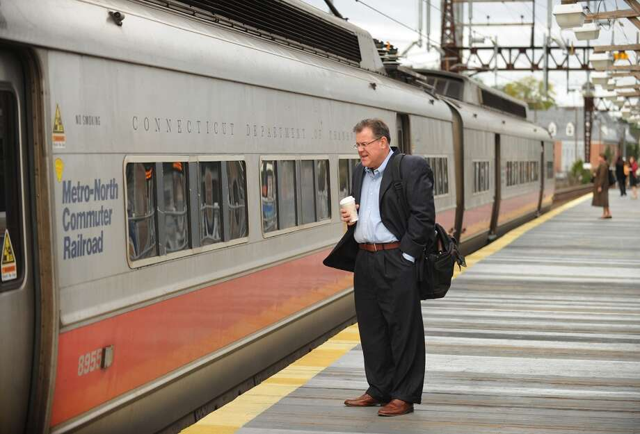 Ed Miska of Fairfield waits to get on his morning commuter train on the sparsely populated platform at the Fairfield station on Thursday, September 26, 2013. A damaged high-voltage feeder cable affected Metro-North rail service on the New Haven Line for days last fall. Photo: Brian A. Pounds
