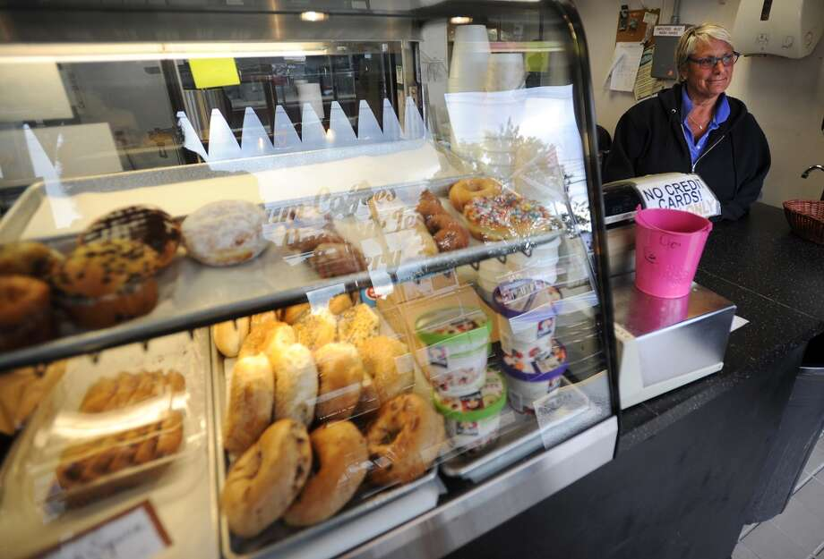 Chat 'n Chew bakery shop employee Sue Montgomery said that business was down drastically as commuters were sparse at the Fairfield train station on Thursday, September 26, 2013.  A damaged high-voltage feeder cable affected Metro-North rail service on the New Haven Line for days last fall. Photo: Brian A. Pounds