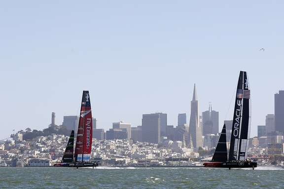 Emirates Team New Zealand (left) pulls ahead of Oracle Team New Zealand on the first leeward leg of Race 18 of the America's Cup Finals on Tuesday, September 24, 2013 in San Francisco, Calif.