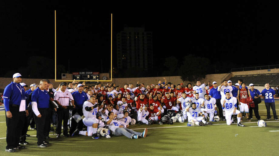 Fox Tech and Lanier coaches and players gather after the final playing of the historic Chili Bowl at Alamo Stadium on Nov. 7, 2009. The series started in 1942. Photo: Billy Calzada / San Antonio Express-News