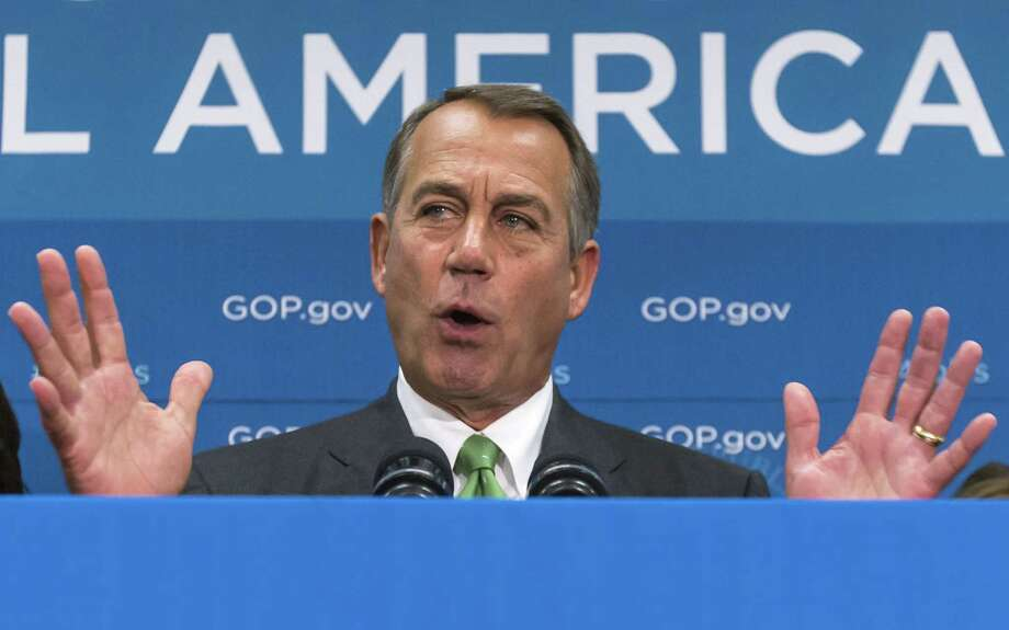 House Speaker John Boehner says a stopgap budget bill without the policy conditions Republicans seek is not likely. Photo: J. Scott Applewhite / Associated Press