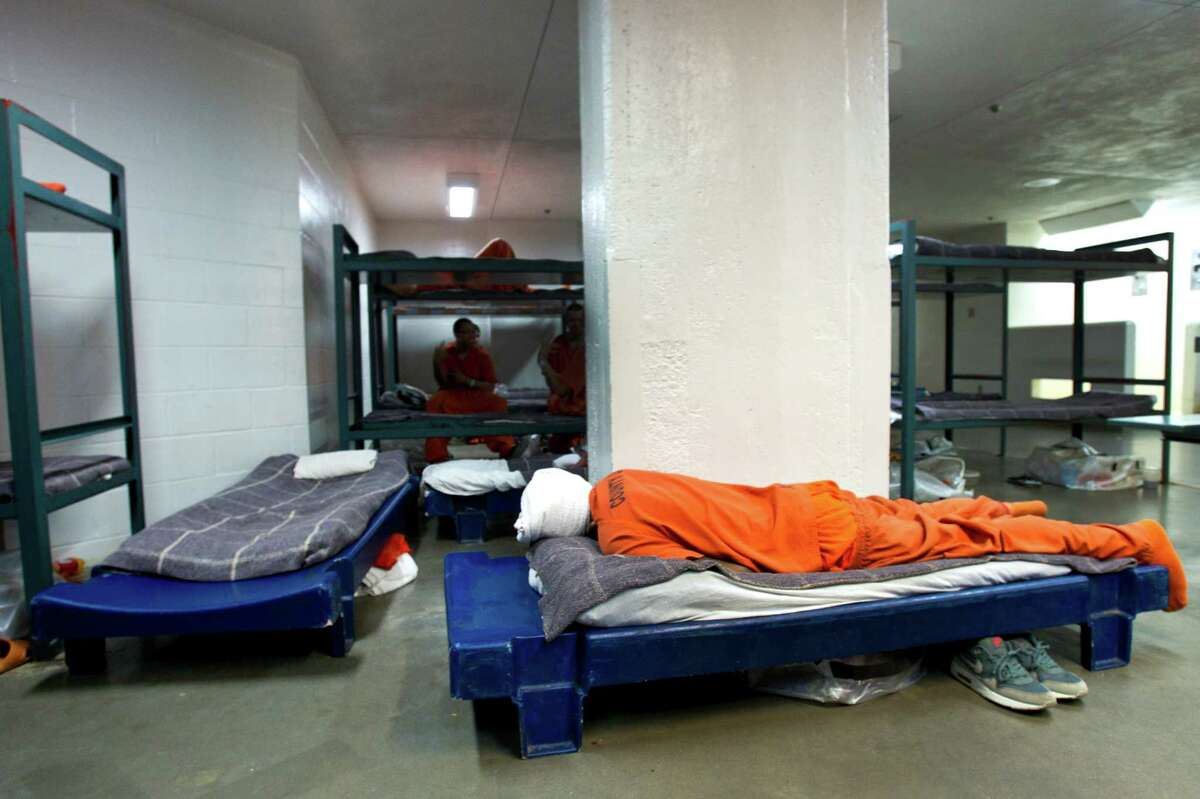 An inmate sleeps at the Harris County Jail on Thursday. The population is near capacity and most of the variance beds are being used for inmates to sleep on.
