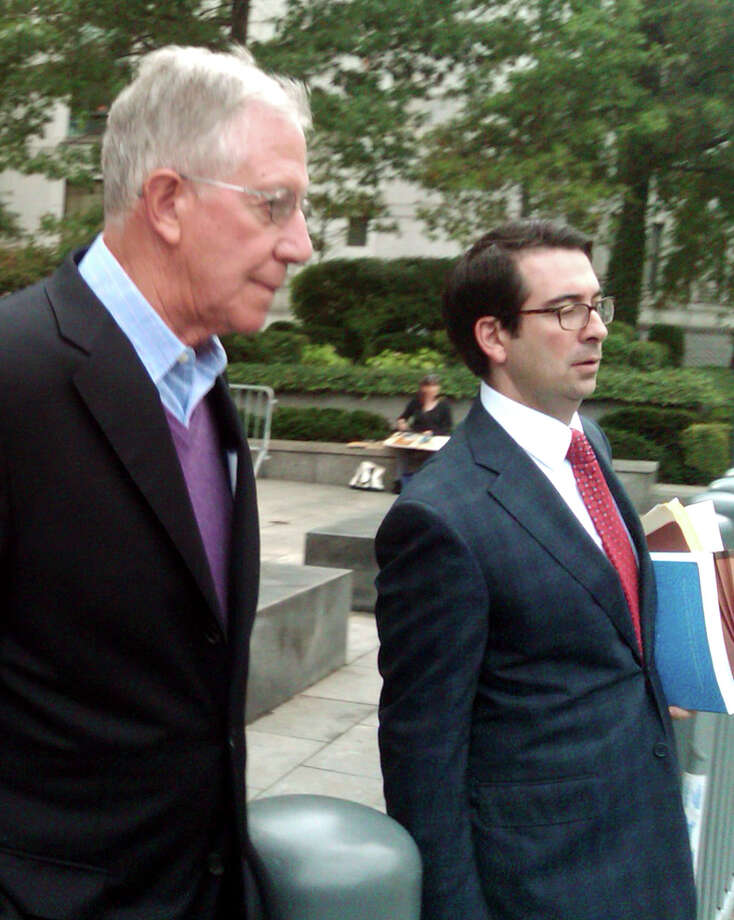 Paul Konigsberg, left, leaves court in New York with his lawyer, Reed Brodsky, Thursday, Sept. 26, 2013, after pleading not guilty to charges that he aided jailed financier Bernard Madoff in his Ponzi scheme.  Prosecutors say that he directed false bookkeeping that enabled Madoff to fool thousands of investors while he squandered nearly $20 billion of their money. (AP Photo/Larry Neumeister) Photo: Larry Neumesiter, STF / AP