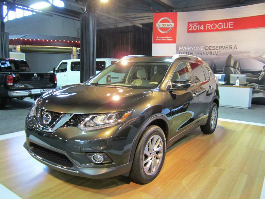 The 2014 Nissan Rogue, on showcase at the State Fair of Texas auto show this year, can store an eight-foot ladder when owners tuck the passenger seats away. Photo: Neal Morton/Express-News