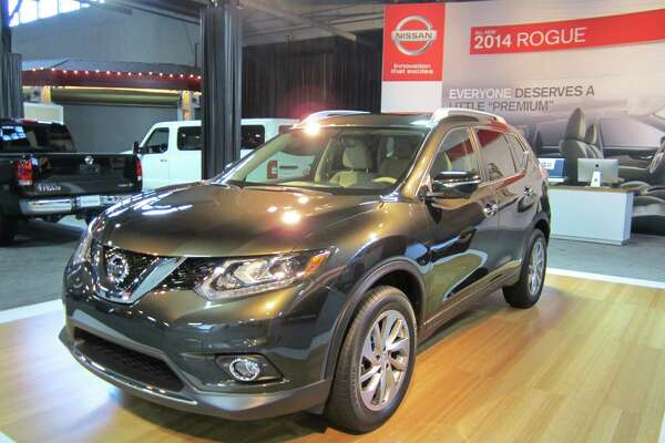 The 2014 Nissan Rogue, on showcase at the State Fair of Texas auto show this year, can store an eight-foot ladder when owners tuck the passenger seats away.