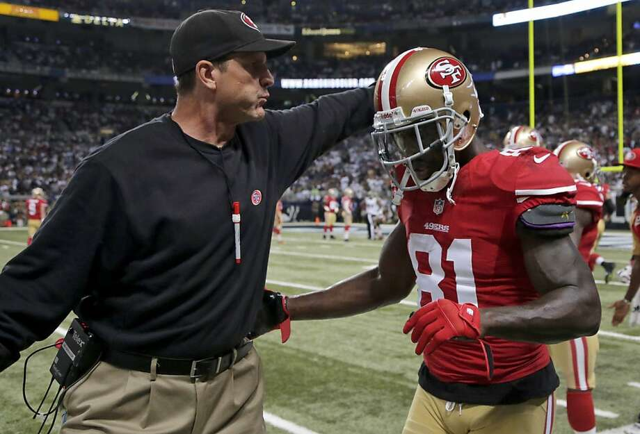 Jim Harbaugh pats Anquan Boldin after his 20-yard touchdown. Photo: Charlie Riedel, Associated Press