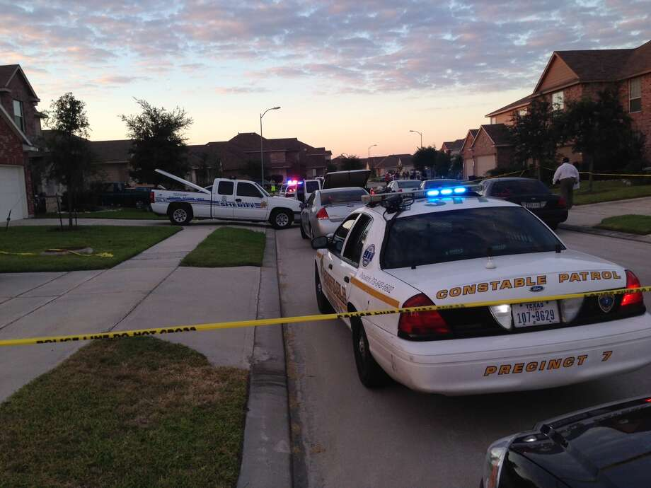 A female robbery suspect was found dead, and her two alleged accomplices fled, after a home invasion Thursday evening inthe 14400 block of Cypress Meadow. (Mike Glenn/Chronicle)