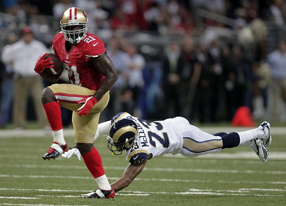 San Francisco 49ers running back Frank Gore, left, runs past St. Louis Rams safety Rodney McLeod on his way to a 34-yard touchdown during the second quarter of an NFL football game Thursday, Sept. 26, 2013, in St. Louis.
