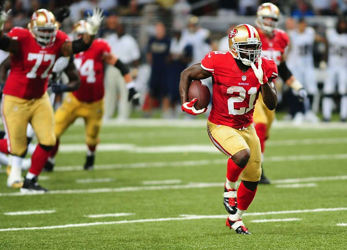 Frank Gore of the San Francisco 49ers runs for a touchdown against the St. Louis Rams at the Edward Jones Dome on September 26, 2013 in St. Louis, Missouri.
