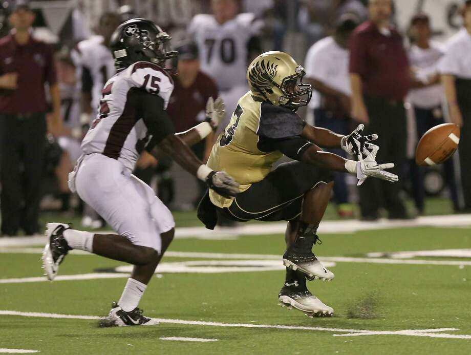 9/26/13: Foster Falcons Marquese Green #3 drops the ball while George Ranch Alfred Wande #15 defends in a 4A High School football game at Traylor Stadium in Rosenberg, Texas. Photo: Thomas B. Shea, Houston Chronicle / © 2013 Thomas B. Shea