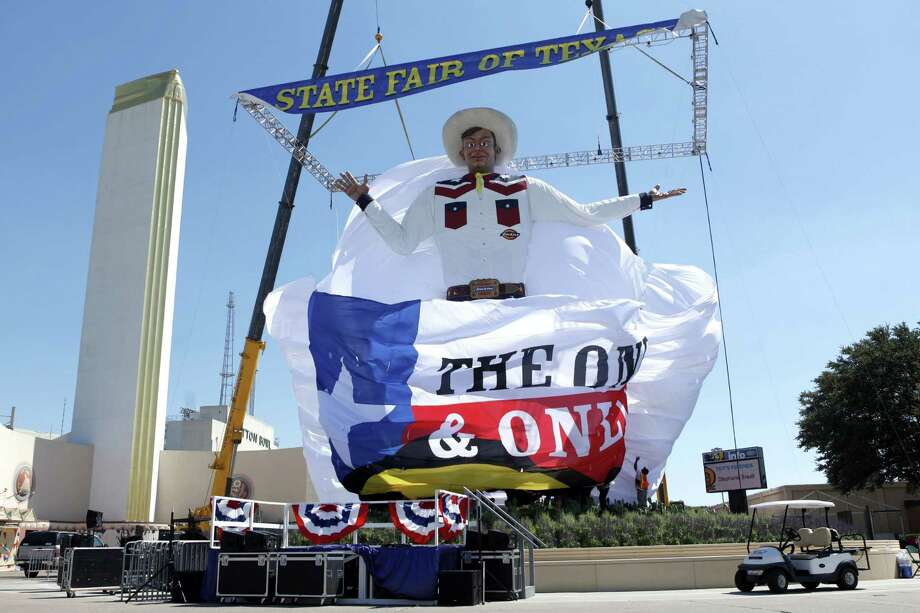 Because of high winds, the curtain was dropped and the new Big Tex was revealed to the public Thursday, a day earlier than expected at the State Fair of Texas. He was erected in the middle of the night early Thursday. Photo: McClatchy-Tribune News Service