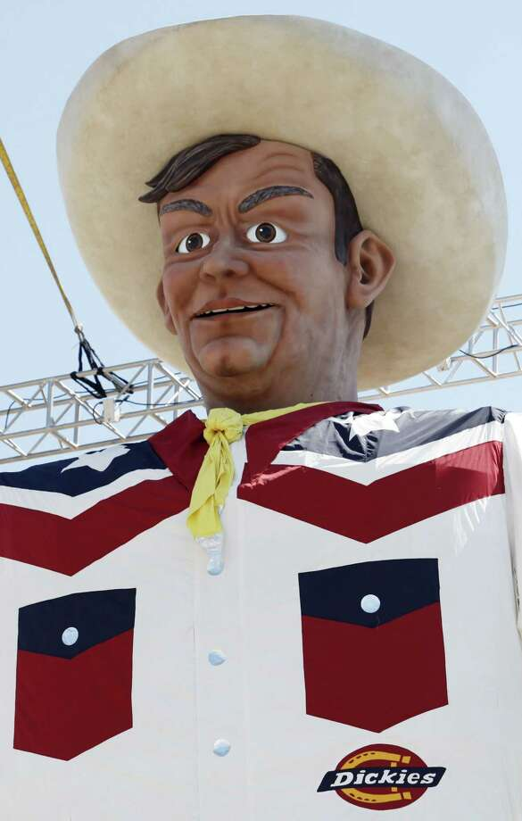 Because of high winds the curtain was dropped and the new Big Tex was revealed to the public a day earlier than expected at the State Fair of Texas, Thursday, September 26, 2013. He was erected in the middle of the night earlier today. (Sarah Hoffman/Dallas Morning News/MCT) Photo: McClatchy-Tribune News Service / Dallas Morning News