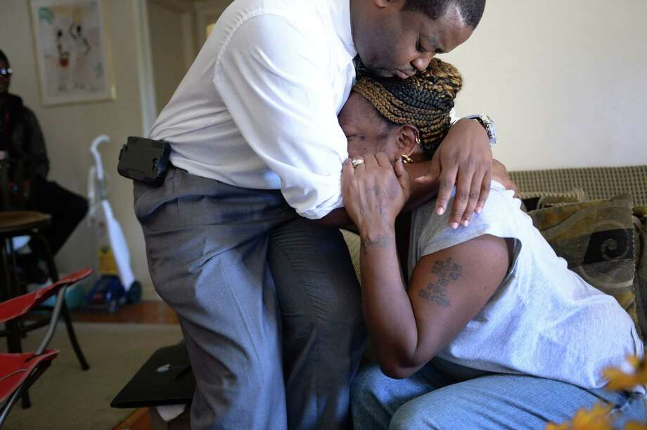 Priscilla Daniels, wife of Arthur Daniels, killed in a gunman's rampage at the Navy Yard, is comforted Sept. 17 by Lynnell Humphrey, who came to assist the family with funeral arrangements. Photo: Jonathan Newton / Associated Press
