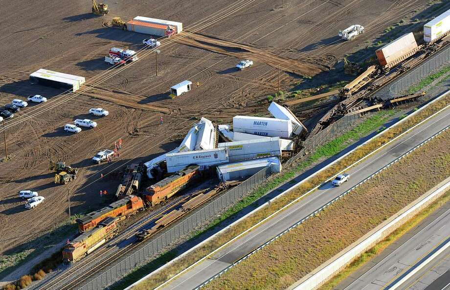 This aerial photo shows the scene where three freight trains collided near Amarillo, Texas on Wednesday, Sept. 25, 2013. An eastbound BNSF Railway train rear-ended a stopped train, derailing up to 30 cars and injuring four crewmembers including two critically. Photo: AP
