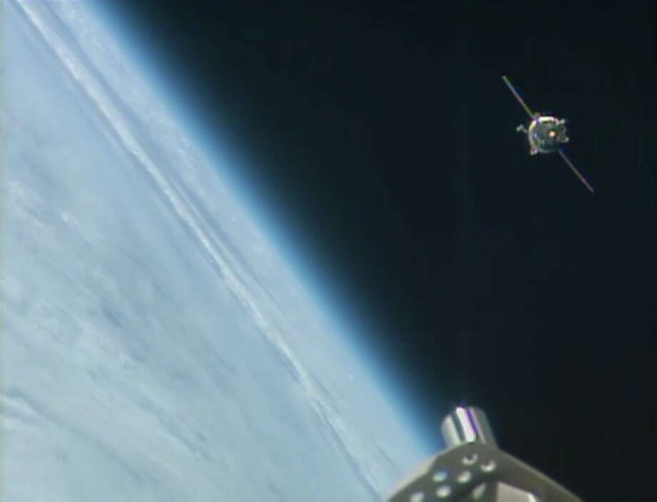 This image from NASA-TV shows the Soyuz capsule, upper right, carrying three astronauts approaching the International Space Station Wednesday, Sept. 25, 2013 bringing the size of the crew at the orbiting outpost to six. The Soyuz capsule successfully docked with the International Space Station at approximately 10:45 p.m. EDT Wednesday. Photo: AP