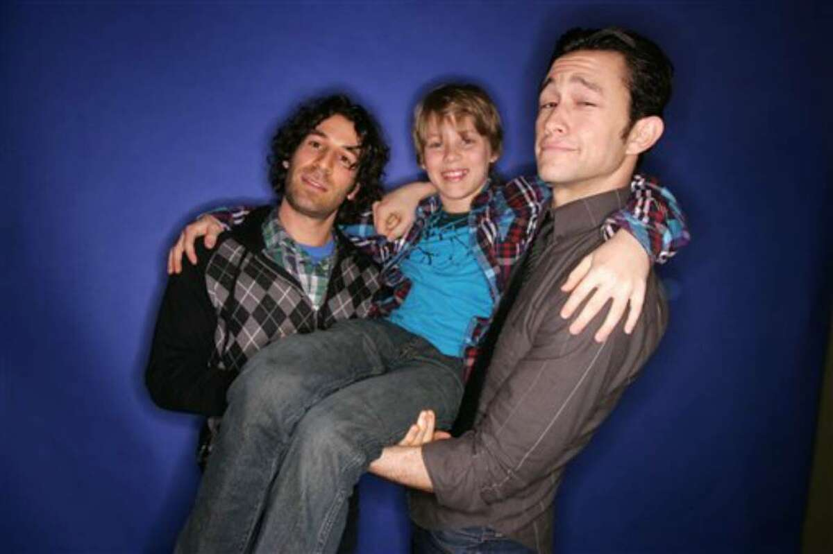 Director Spencer Susser, left, actors Devin Brochu and Joseph Gordon-Levitt, right, of the film Hesher pose for a portrait during Sundance Film Festival in Park City, Utah on Saturday, January 23, 2010. (AP Photo/Carlo Allegri)