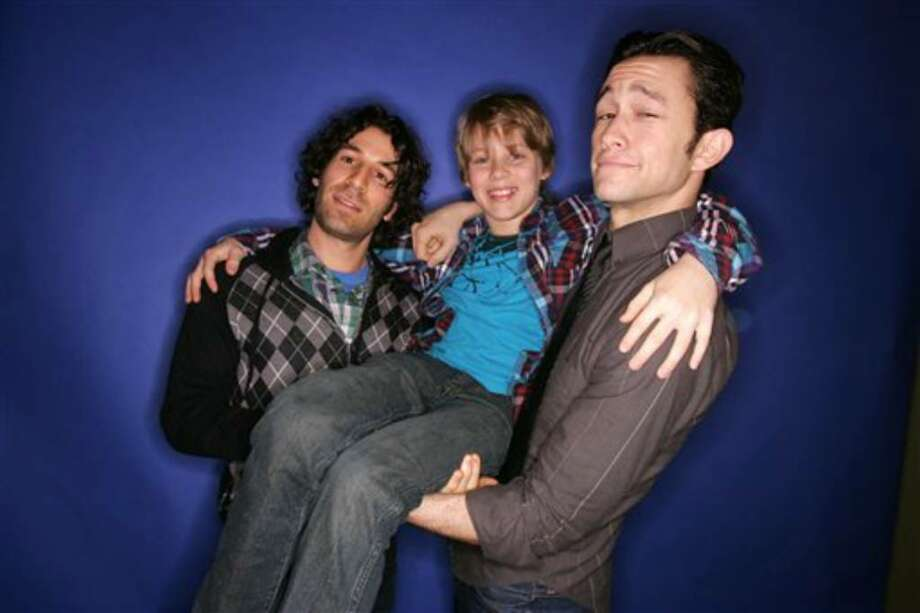 Director Spencer Susser, left, actors Devin Brochu and Joseph Gordon-Levitt, right, of the film Hesher pose for a portrait during Sundance Film Festival in Park City, Utah on Saturday, January 23, 2010.  (AP Photo/Carlo Allegri) Photo: Carlo Allegri, ASSOCIATED PRESS / AP2010