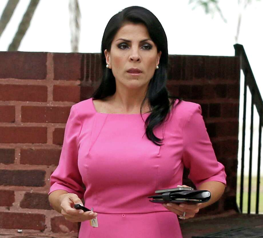 In this Nov. 13, 2012, file photo, Jill Kelley leaves her home in Tampa, Fla.   The Obama administration on Sept. 24, 2013, sought dismissal of a lawsuit by Kelley whose complaint to the FBI led to Gen. David Petraeus' ouster as CIA director. If a federal judge allows the lawsuit by Kelley to proceed, the case could delve into the roles played in the Petraeus scandal by the FBI, the Pentagon and other parts of the Obama administration. Photo: AP