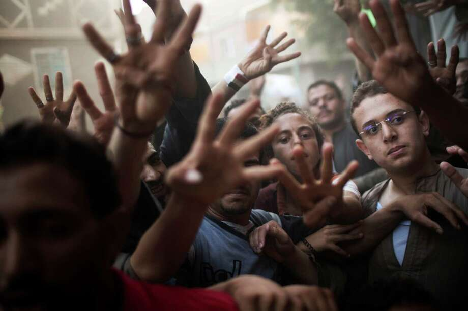 FILE - In this Sept. 17, 2013, file photo, supporters of Egypt's ousted President Mohammed Morsi chant slogans against the Egyptian Army during a protest in Dalga, Egypt, south of Cairo. With the start of school this week, young activists of the Muslim Brotherhood have taken the lead in the group's protests against the military coup that ousted Islamist President Mohammed Morsi. Photo: AP