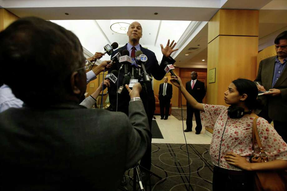 Newark Mayor and senate candidate Cory Booker answers a question in Newark, N.J., Thursday, Sept. 26, 2013. Booker says the disclosure that he messaged with a stripper isn't going to change anything about how he uses Twitter. The Democratic mayor of Newark, N.J., told reporters Thursday he communicates with thousands of people on Twitter and doesn't pay attention to their handles or profession. Photo: AP
