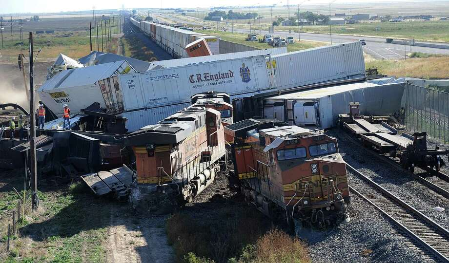 Cars are derailed where three freight trains collided near Amarillo, Texas on Wednesday, Sept. 25, 2013. An eastbound BNSF Railway train rear-ended a stopped train, derailing up to 30 cars and injuring four crewmembers including two critically. Photo: AP