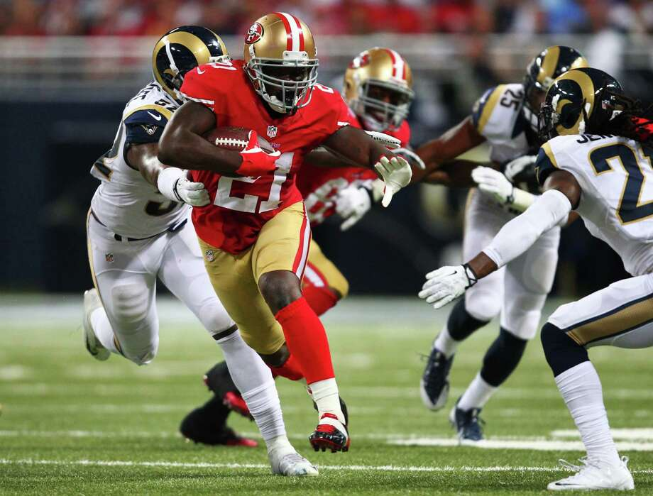 ST LOUIS, MO - SEPTEMBER 26:   Frank Gore #21 of the San Francisco 49ers runs for 17 yards against the St. Louis Rams in the second quarter at Edward Jones Dome on September 26, 2013 in St Louis, Missouri.  (Photo by Dilip Vishwanat/Getty Images) ORG XMIT: 175929057 Photo: Dilip Vishwanat / 2013 Getty Images