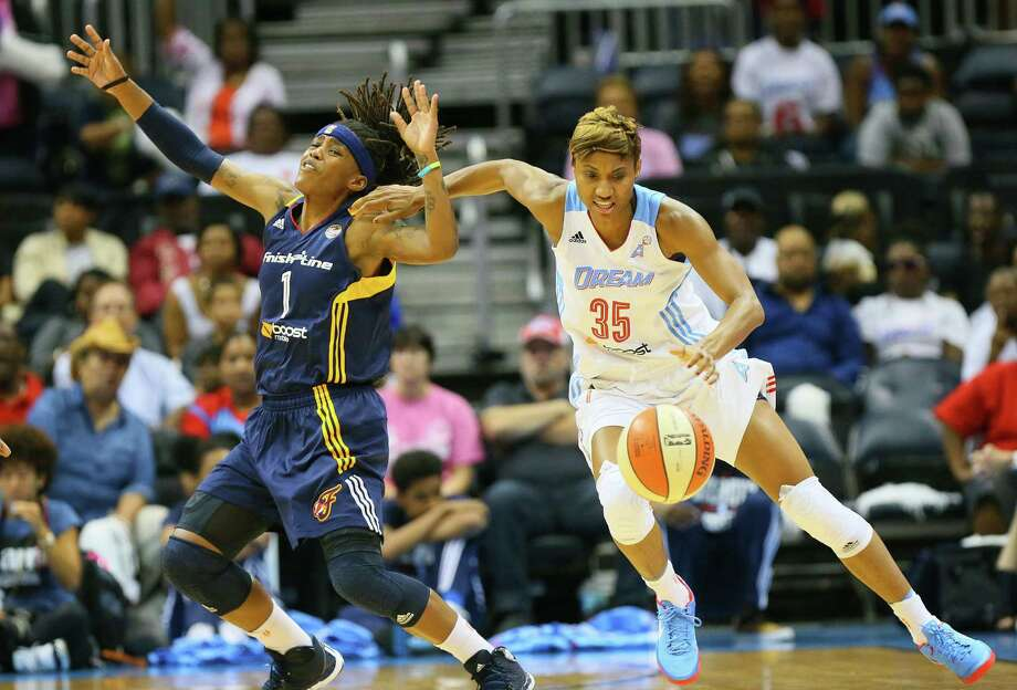 The Dream's Angel McCoughtry (35), who had 18 points, steals the ball from the Fever's Shavonte Zellous on Wednesday. Photo: Curtis Compton / Atlanta Journal-Constitution