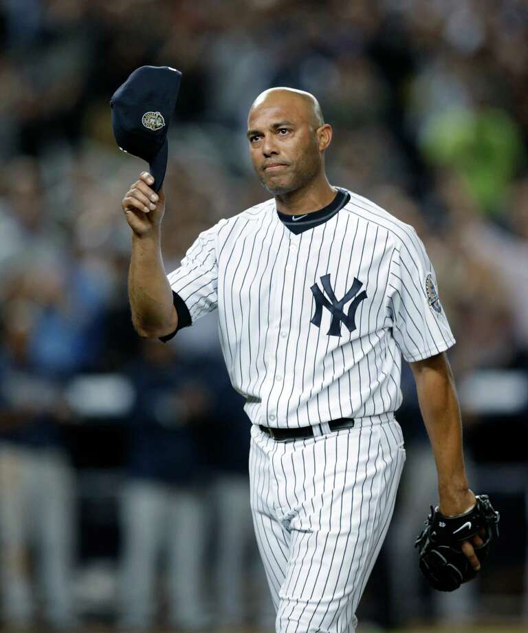 New York Yankees relief pitcher Mariano Rivera (42) tips his cap in the ninth inning of his final appearance in a baseball game at Yankee Stadium, against the Tampa Bay Rays on Thursday, Sept. 26, 2013, in New York. The Yankees won 4-0. (AP Photo/Kathy Willens) ORG XMIT: NYY112 Photo: Kathy Willens / AP