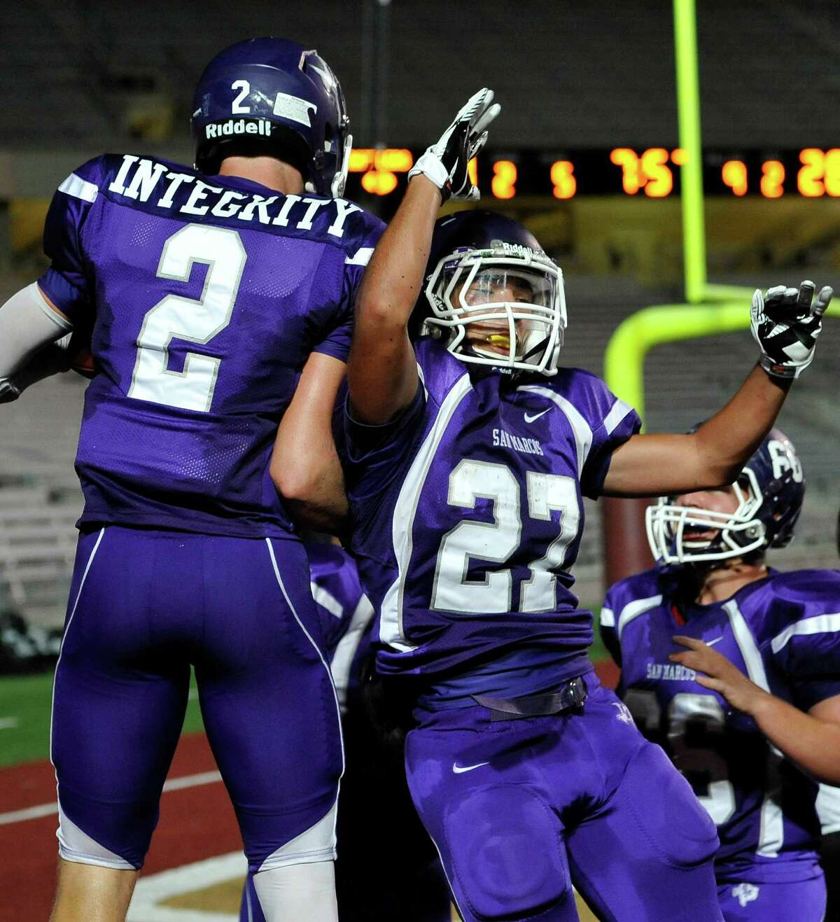 San Marcos players Zach Sterling, left, and Jacob Mendoza celebrate a touchdown during the first half of a high school football game against Steele, Thursday, Sept. 26, 2013, at Bobcat Stadium in San Marcos, Texas. (Darren Abate/For the Express-News)