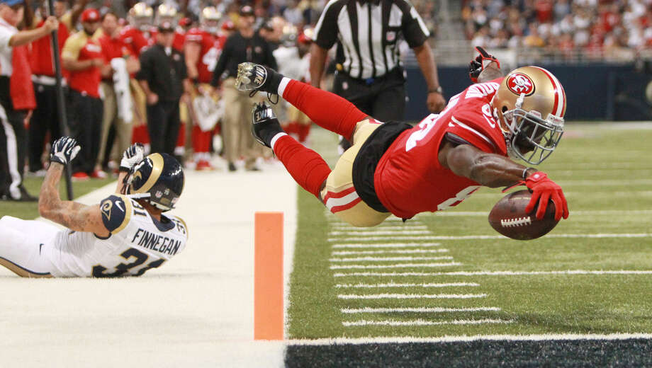 49ers wide receiver Anquan Boldin (right) dives into the end zone to score on a 20-yard TD in the second quarter shortly after making a 42-yard catch. Photo: Chris Lee / Associated Press