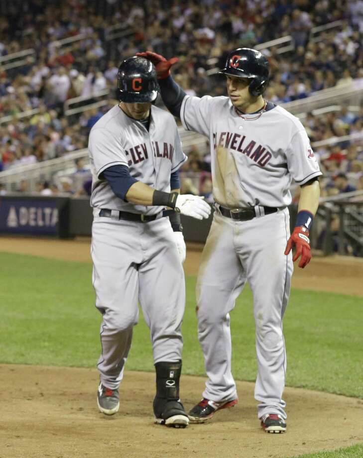 Cleveland's Asdrubal Cabrera (right) congratulates teammate Yan Gomes after Gomes' two-run homer. Photo: Jim Mone / Associated Press