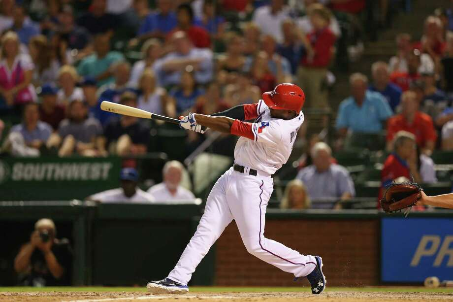 Rangers pinch-hitter Jurickson Profar follows through on his game-winning homer to right field in the ninth inning against the Angels. Texas is a game out of a playoff spot with three to play. Photo: Ronald Martinez / Getty Images