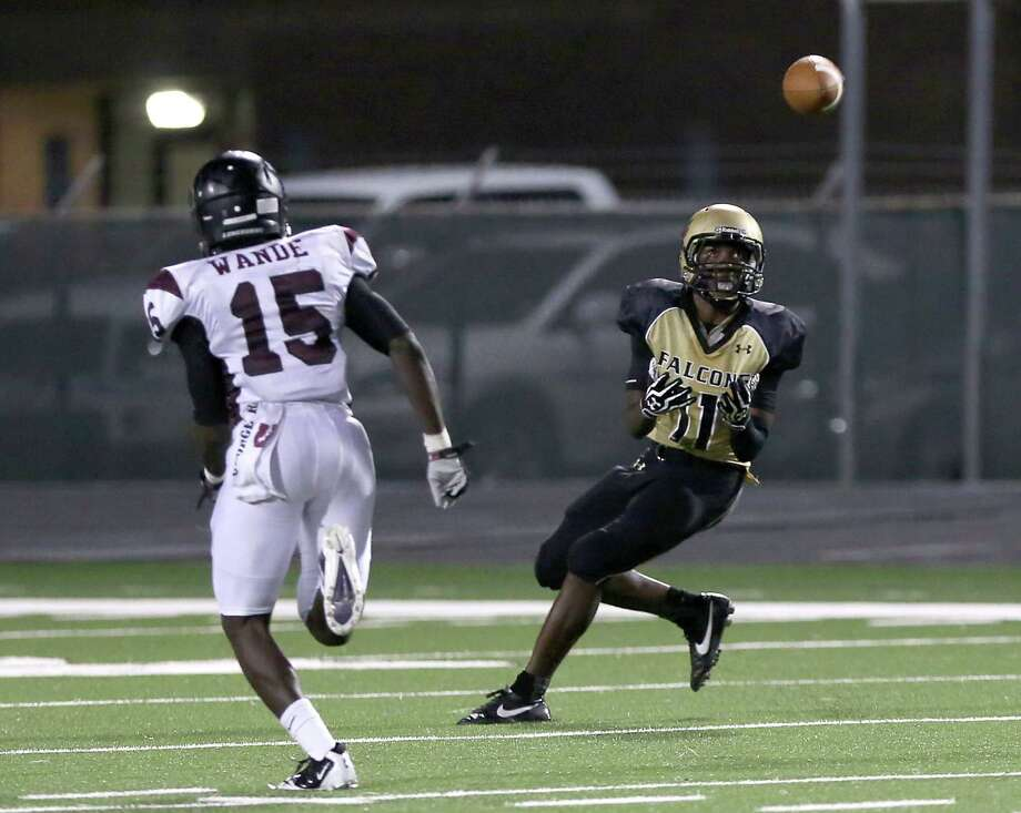 9/26/13: Foster Falcons' Brandon Taylor #11 makes a catch while George Ranch Longhorns' Alfred Wande #15 defends  in a 4A High School football game at Traylor Stadium in Rosenberg, Texas. Photo: Thomas B. Shea, Houston Chronicle / © 2013 Thomas B. Shea