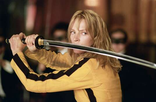 """Kill Bill Vol. 1"" – In the first volume of this gritty revenge saga, an assassin is shot at the altar by her ruthless employer, Bill, and other members of their assassination circle. But she survives and sets out to kill all those who wronged her, saving Bill for last. Available Now! Photo: Andrew Cooper, Miramax Films"