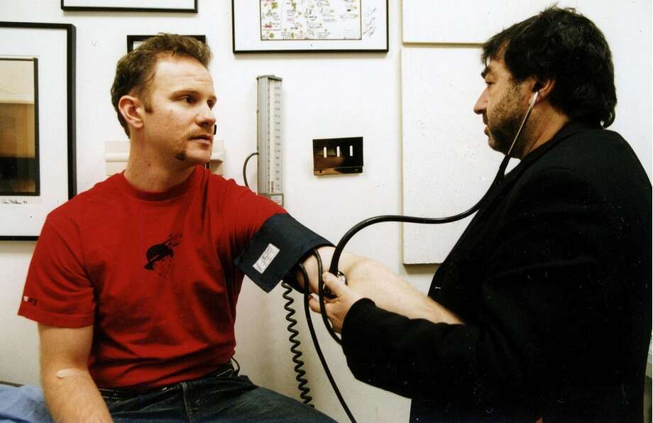 Filmmaker Morgan Spurlock checks his blood pressure after eating in McDonald's in this documentary SUPER SIZE ME. (debbie 2008) Photo: HANDOUT