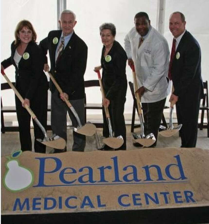 Getting behind a shovel to begin construction of the HCA Affiliated, Pearland Medical Center are (left to right) HCA Gulf Coast Division President Maura Walsh, Pearland Mayor Tom Reid, Manvel Mayor Delores Martin, Medical Director of HealthOne 24 Hour Eme Photo: Photo Provided