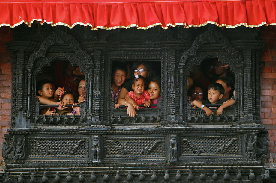Devotees watch celebrations to mark the week-long Indra Jatra festival in Katmandu, Nepal, Wednesday, Sept. 18. The festival marks the end of the monsoon season and is celebrated by both Hindus and Buddhists. Photo: Niranjan Shrestha, AP / AP