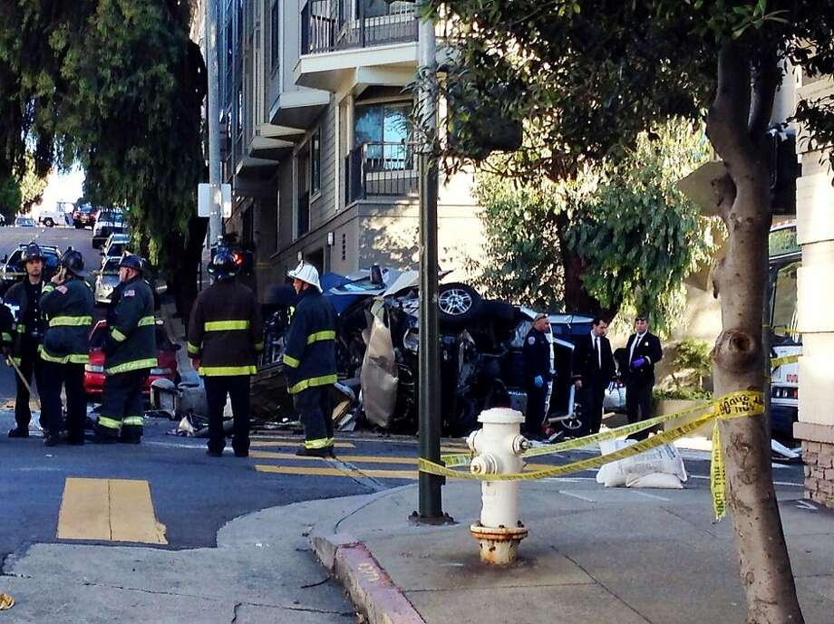 The scene at Pine and Gough streets in San Francisco, where a 17-year-old boy was killed when a car rammed the minivan in which he was a passenger Sept. 27, 2013. Photo: Kurtis Alexander/The Chronicle