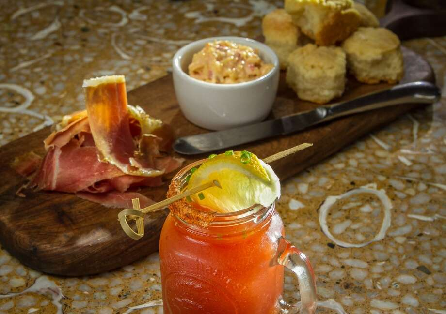 The Tomales Bay Vodka Oyster Shooter with the Sliced Kentucky Ham, Estero Gold Pimento Chese, and Tiny Buttermilk Biscuits at Rocker Oysterfeller's In Valley Ford. Photo: John Storey, Special To The Chronicle