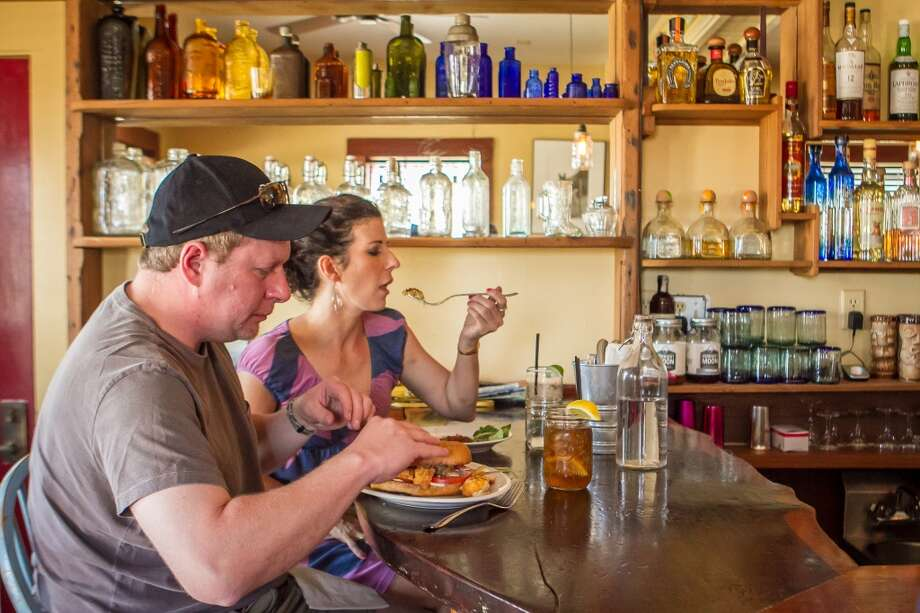A couple has drinks and oysters at Rocker Oysterfeller's In Valley Ford. Photo: John Storey, Special To The Chronicle