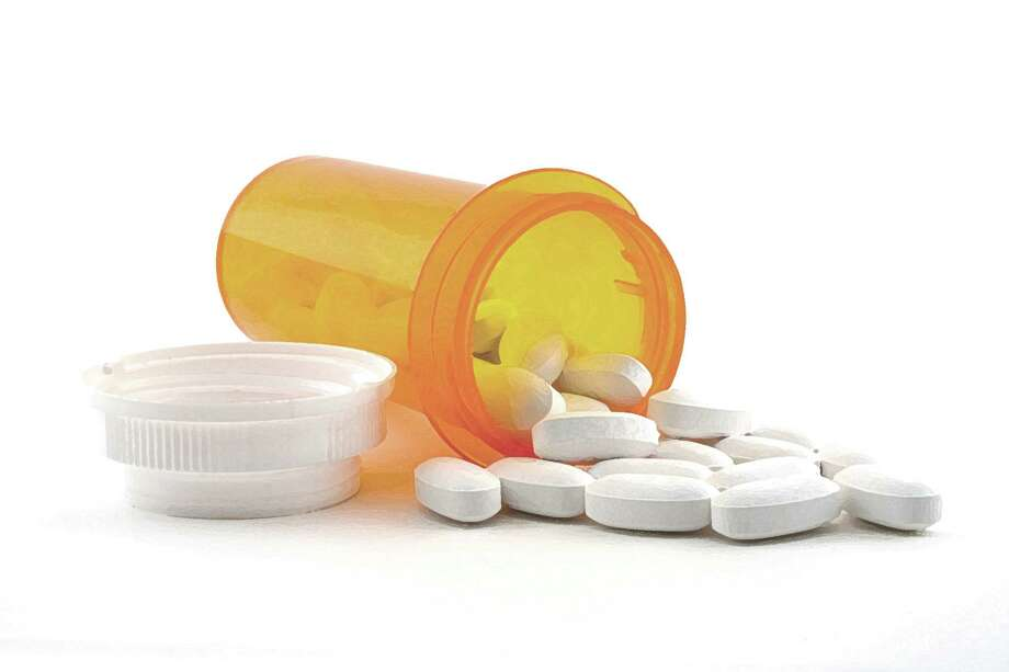 prescription drugs pills medication spilled pills prescription medicine / handout / stock agency