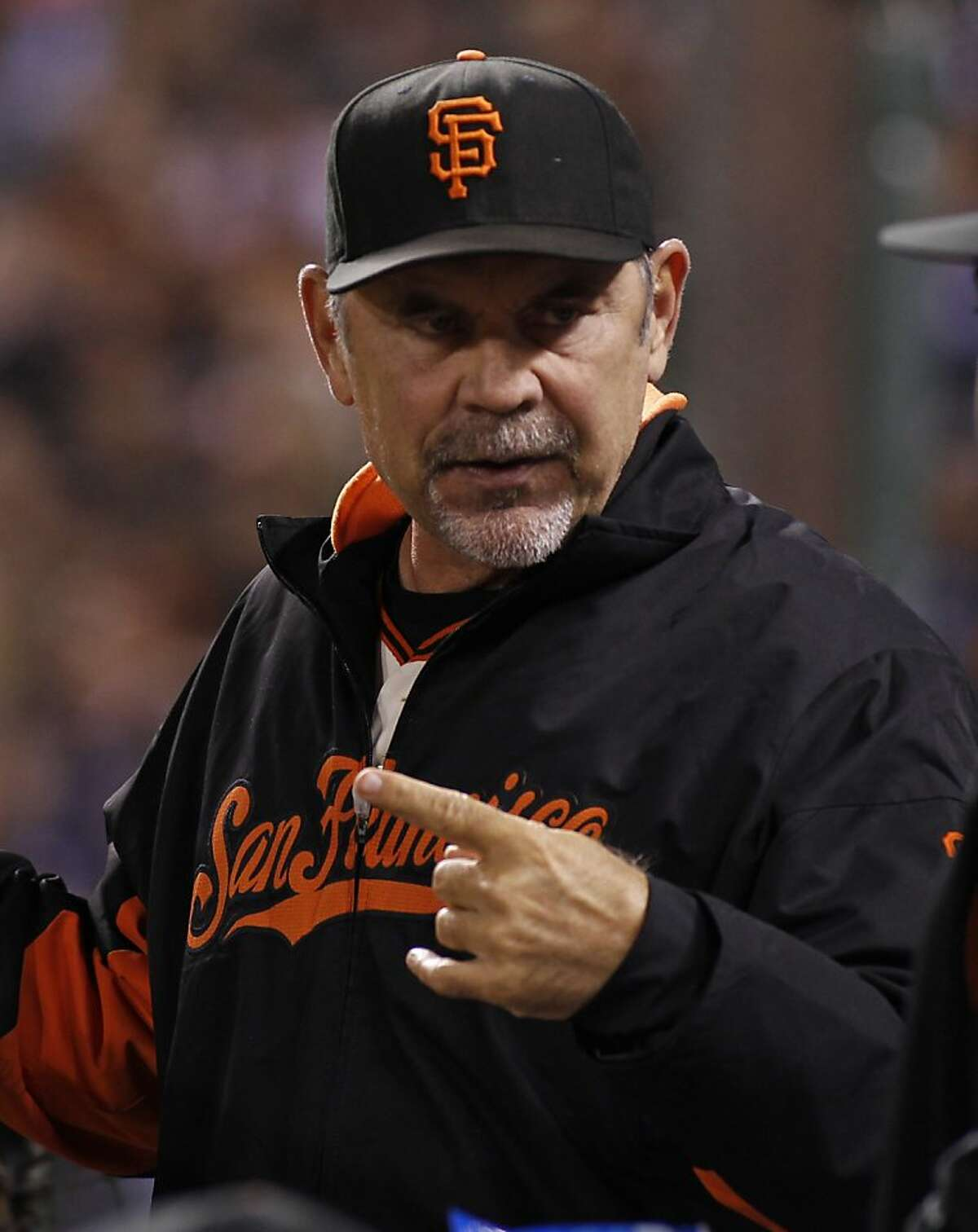 San Francisco Giants manager Bruce Bochy in the dugout during the eighth inning of a baseball game against the Los Angeles Dodgers in San Francisco, Thursday, Sept. 26, 2013.