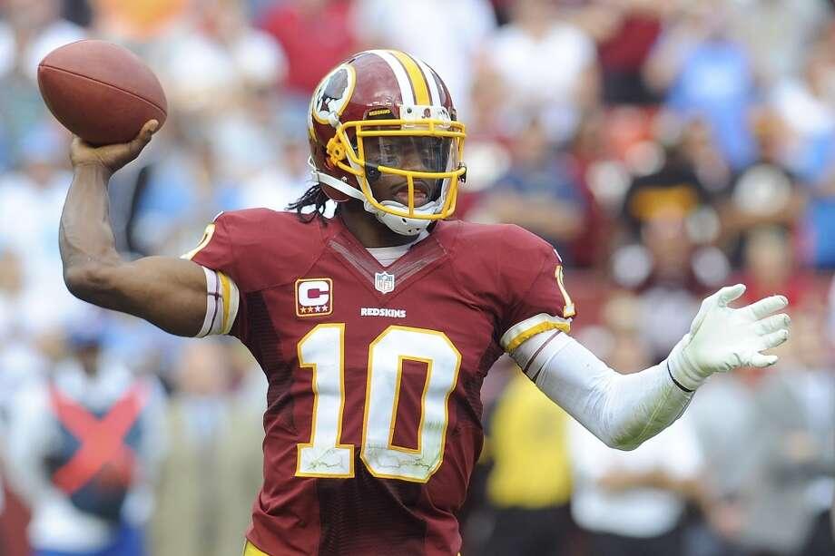 Washington (0-3) minus-3 at Oakland (1-2): Redskins 27-20 Photo: Richard Lipski, Associated Press