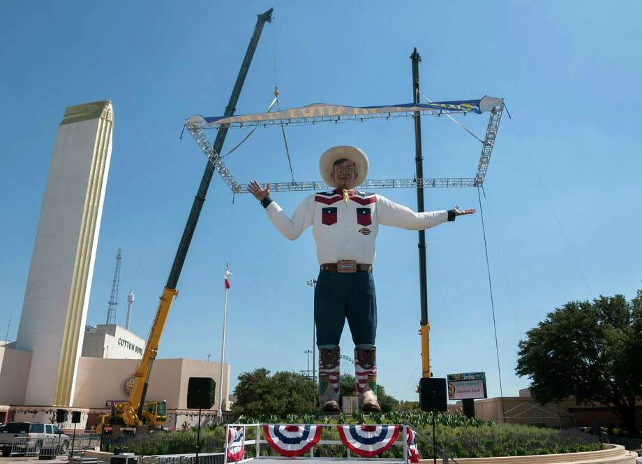 Big Tex, the 55-foot-tall symbol of the State Fair of Texas, is unveiled Thursday, Sept. 26, 2013, one day earlier than scheduled, in Dallas. Big Tex was supposed to be revealed Friday, before television news helicopters caught a glimpse of the head surrounded on four sides by draping. He was rebuilt for this year after going up in flames in the closing days of the fair last year. Photo: Rex C. Curry